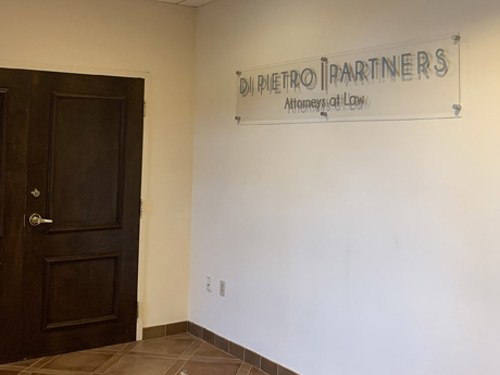 A sign inside the law firm of Di Pietro Partners that reads Di Pietro Partners attorneys at law