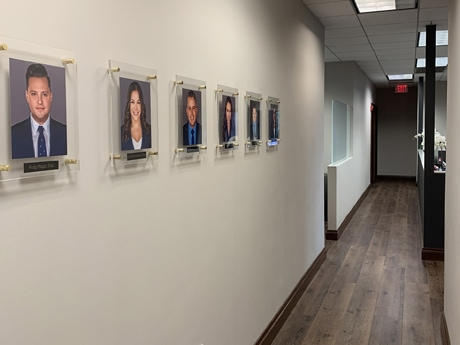 Hallway with individual attorney photos posted on the wall. These are photos of probate and healthcare attorneys at Di Pietro Partners