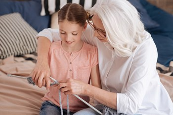 Visual link to the guardianship practice area page showing a grandmother with her granddaughter