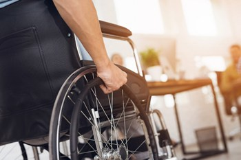 Visual link to the medical malpractice practice area page showing a patient on a wheelchair