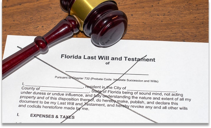 Physical copy of a Florida Last Will and Testament that's crossed off in black marker to symbolize dying without a will which leads to intestate succession