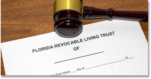 Physical copy of a Florida Revocable Living Trust with a judges gavel above it symbolizing trust litigation