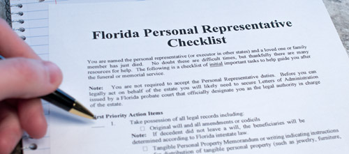 Sample of a legal form used by personal representatives that's titled Florida Personal Representative Checklist. The document has checkboxes and someone about to fill it out.