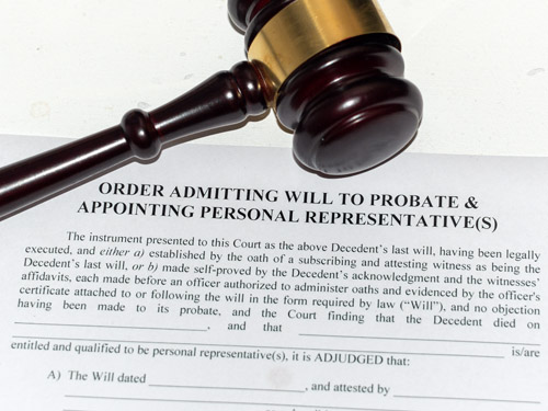 Judge gavel on top of an Order admitting Will to Probate form.